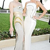 Doutzen Kroes (with Milla Jovovich, left) wore Versace at the 2012 amfAR Gala at Cannes in May 2012.