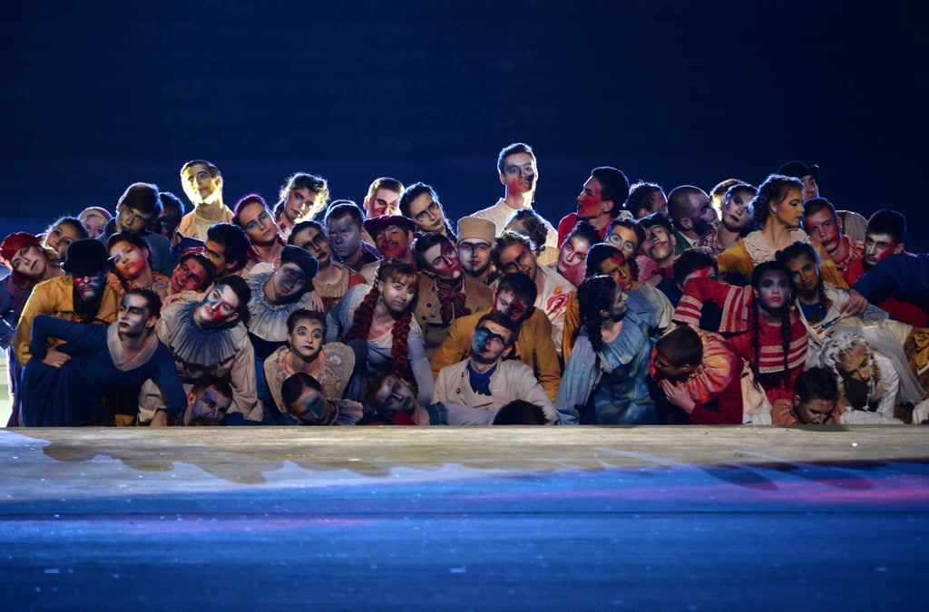 Artists grouped together for a performance during the closing ceremony.