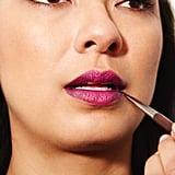 Step 4: Blend the black lipstick in upward motions.