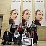 """Women from the feminist group """"La Barbe"""" (The Beard) protest against L'Oréal for not having enough women in management positions."""