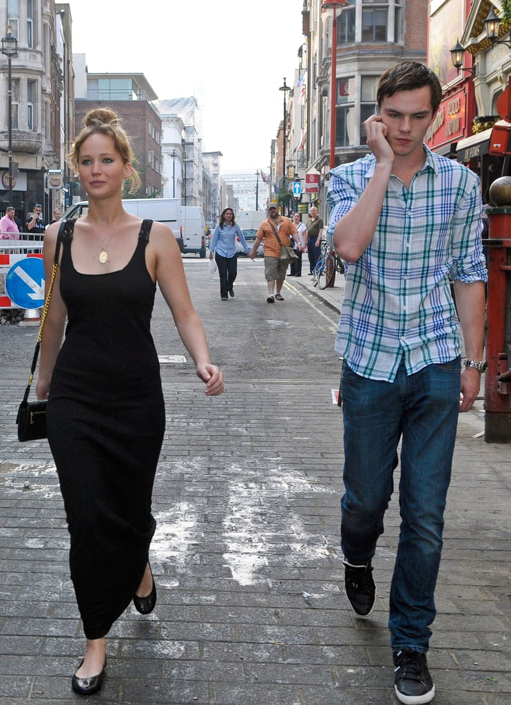 Then later on, while strolling London with boyfriend Nicholas Hoult, Jennifer changed into a black maxi with Tory Burch Eddie black patent flats ($178) and a quilted Marc Jacobs bag ($595).  6958797