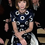 Anna Wintour showed off a silky floral dress and a colorful jeweled necklace while sitting front row at Saint Laurent.
