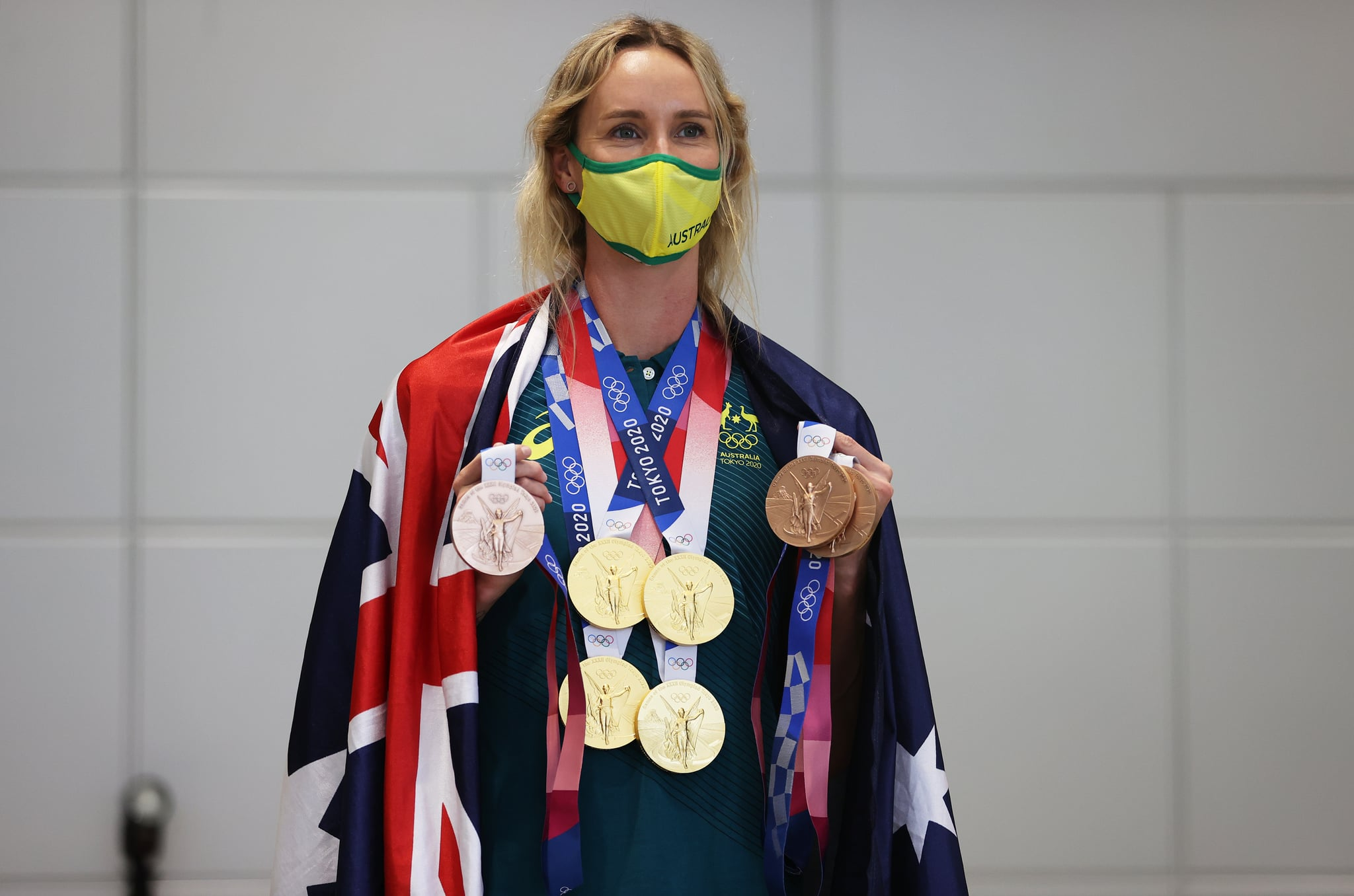 TOKYO, JAPAN - AUGUST 02: Emma McKeon of Team Australia poses for a photo with her seven Olympics medals after the Australian Swimming Medallist press conference on day ten of the Tokyo Olympic Games on August 02, 2021 in Tokyo, Japan. (Photo by James Chance/Getty Images)