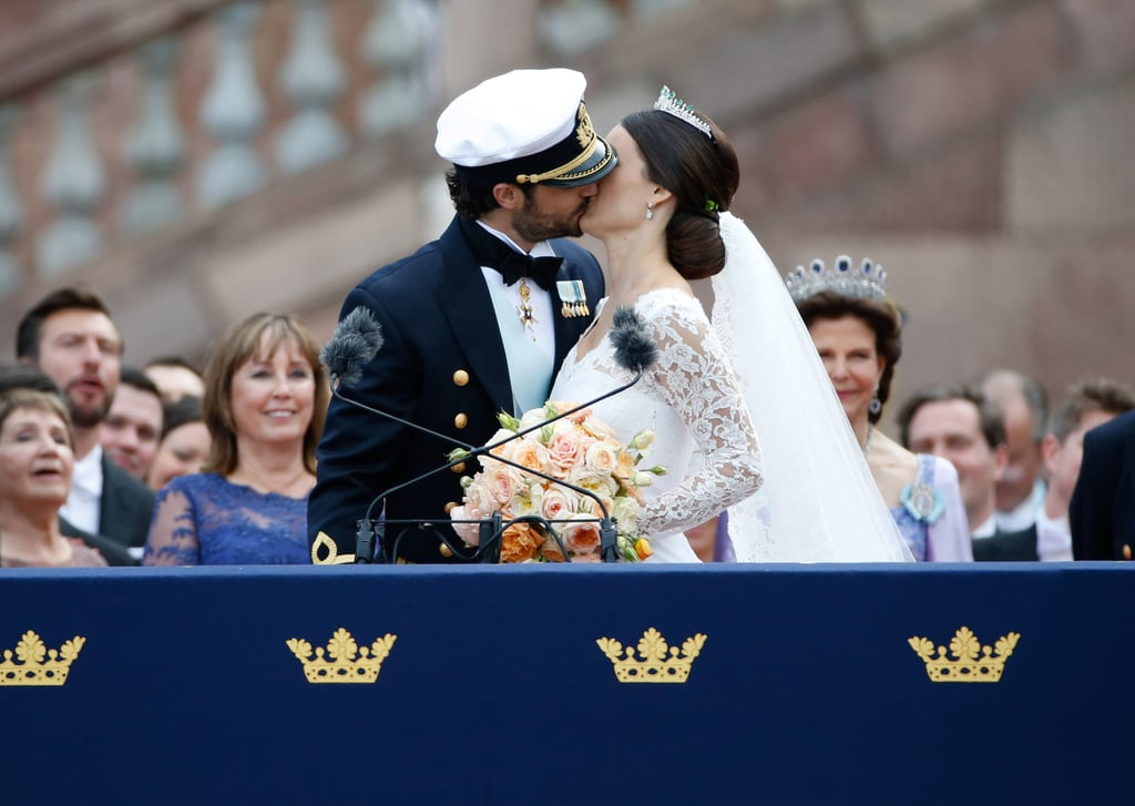 Both royal couples locked lips for the gathered crowds after making it official.