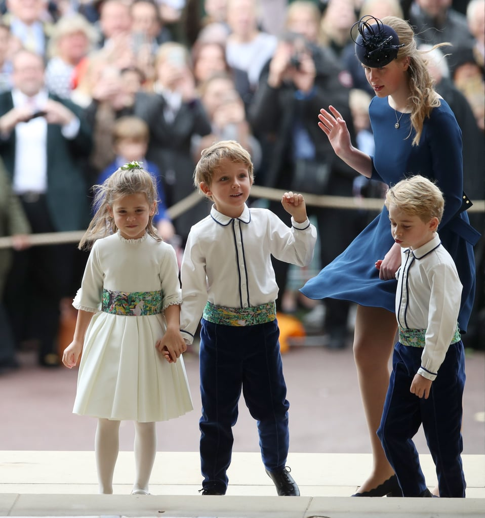 George, visibly over all of it, pulls Lady Louise Mountbatten-Windsor into the chapel.