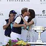 William gets a kiss after Kate presents him a player prize and winning trophy.