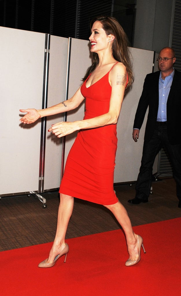 Angelina Jolie ran to catch up with Brad Pitt on the red carpet.