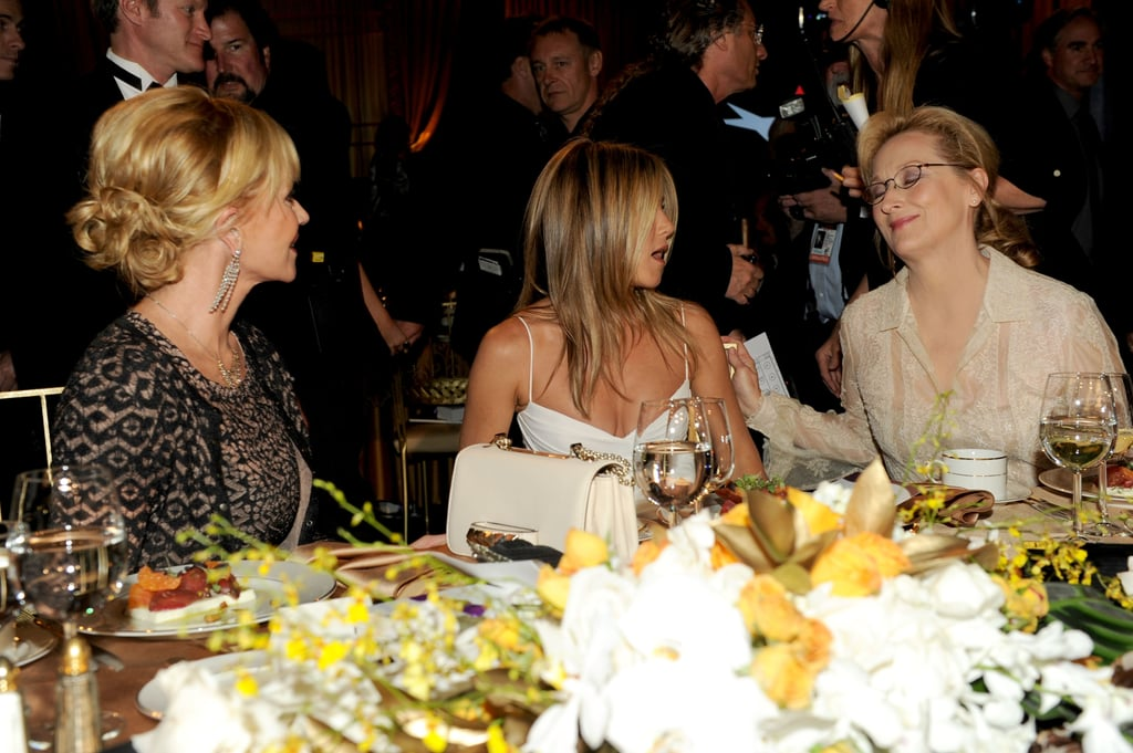 Melanie Griffith, Jennifer Aniston, and Meryl Streep chatted at the AFI Life Achievement Award dinner honouring Shirley MacLaine in LA.