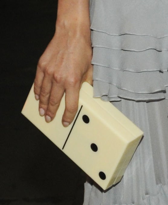 Diane accessorized her look with a fun Charlotte Olympia domino clutch.