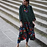 A Long Roomy Dress Over Jeans With Glamorous Earrings