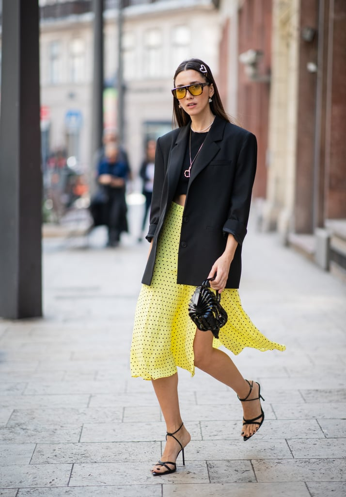 Make your yellow skirt stand out even more by styling it with a black tee and matching blazer.