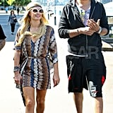 Paris Hilton and boyfriend DJ Afrojack got off of a boat after riding around Sydney Harbor in Australia.