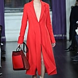 We selected this bright cherry-red coat from Jason's Fall runway, which we could see Michelle pairing with power pumps and her classic hoop earrings.