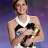 Emma Watson hugged her golden popcorn on stage at the MTV Movie Awards.