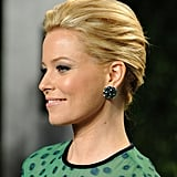 Elizabeth Banks played to ladylike glamour with a pair of jeweled Bulgari studs.