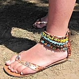 We're hard pressed to find a shoe with as much handiwork as this stone-covered ankle-strap sandal.