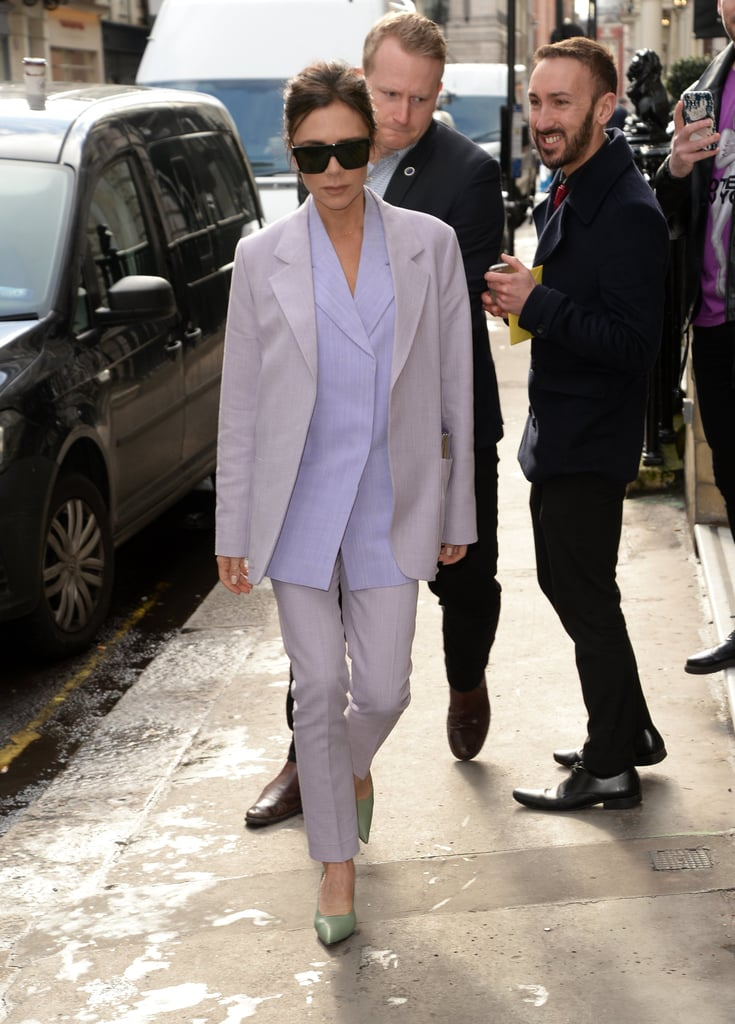Victoria Beckham Wearing a Purple Suit