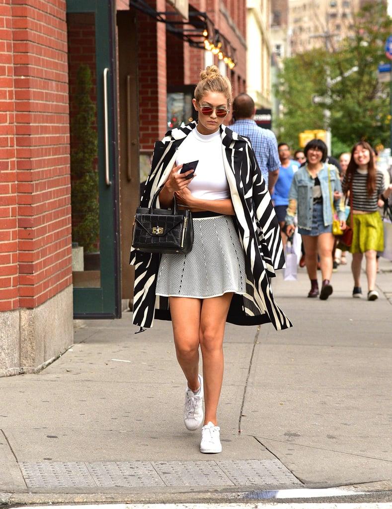 Wearing Adidas Superstars.