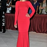 Kasia Smutniak stunned in a form-fitted red Armani Privé gown — while covered up in the more literal sense, this number is totally sexy due to its body-hugging nature.
