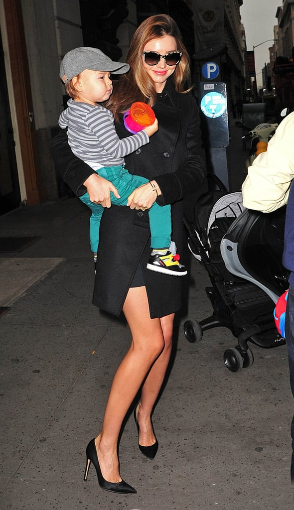 Miranda went ladylike with Flynn in a black double-breasted coat and black pointed-toe stilettos to show off her legs.