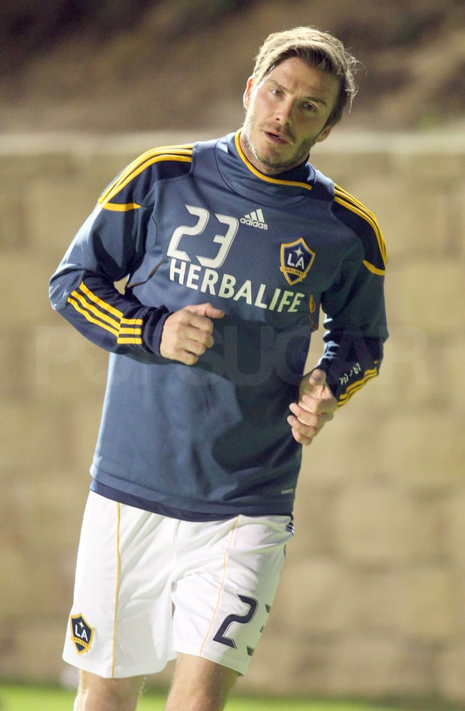 """David Beckham limbered up ahead of the LA Galaxy v Club Tijuana friendly at the Torero Stadium in San Diego yesterday. He was back on the pitch training with the team last weekend, after seven weeks training with Tottenham Hotspur. David played 74 minutes of the match, which the team ultimately lost, and said, """"Obviously, [it's] my first game back, and I felt pretty good at times, and I think the fitness side is good to get out of the way. Once that first game is out of the way, you can move on."""""""