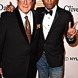 Clive Davis and Pharrell hit the red carpet at the executive's popular bash.