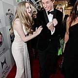 Amanda Seyfried and Eddie Redmayne joked around while heading into the Golden Globes afterparty.