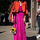 "Instead of wearing a traditional denim jacket over your pink dress, wear a red one. The style switch-up is easy to pull off, as Natalie Suarez showed here. She also wore M Missoni's ""Maxi Tote"" for an extra pop of color."