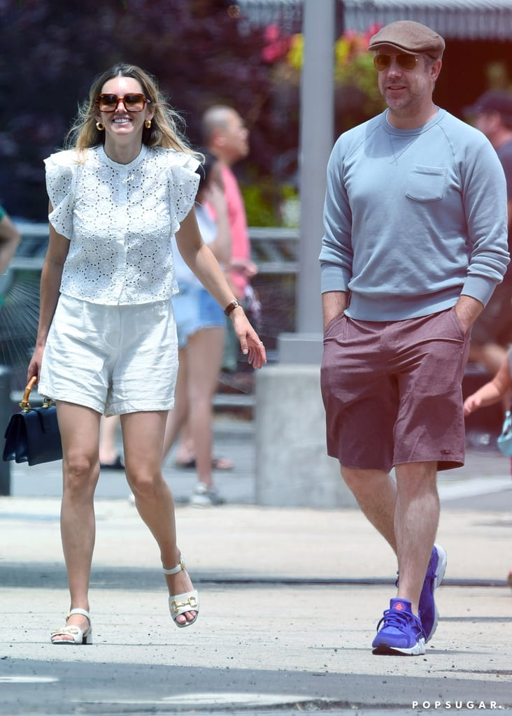 """It seems that critical acclaim isn't the only good thing to come out of Ted Lasso for star Jason Sudeikis. On June 27, Jason continued to spark romance rumors when he was spotted in New York City with his arms around costar Keeley Hazell, who plays Bex, the girlfriend of Anthony Head's Rupert Mannion. While this is the first time the couple have been seen publicly together, they were first linked back in February. """"He's enjoying spending time with her, but [it's] casual for now,"""" a source told E! News at the time. """"They have known each other for a while and have always been friendly. It's been nice for him while he's in London to have someone to spend time with. He's not looking for anything serious.""""  The 45-year-old actor and the 34-year-old model first met while filming 2014's Horrible Bosses 2, in which Keely plays an assistant to Chris Pine's Rex Hanson. This marks Jason's first known relationship since his split from longtime partner Olivia Wilde in November 2020, though they continue to coparent their two kids, Daisy Josephine, 4, and Otis Alexander, 7. See pictures from Jason and Keeley's New York City stroll, ahead."""
