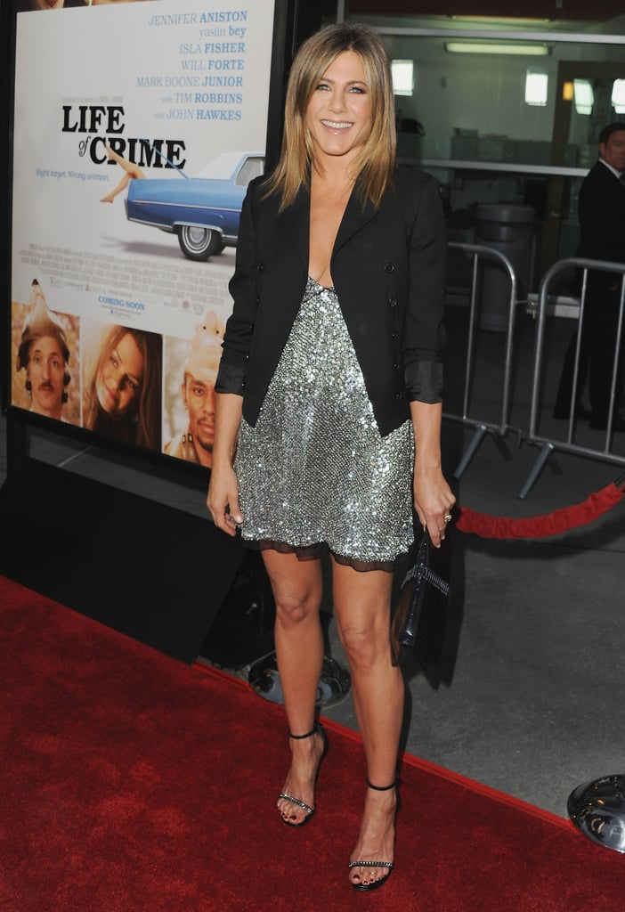 In August 2014, Jennifer wore a slinky silver dress with a black blazer on top.