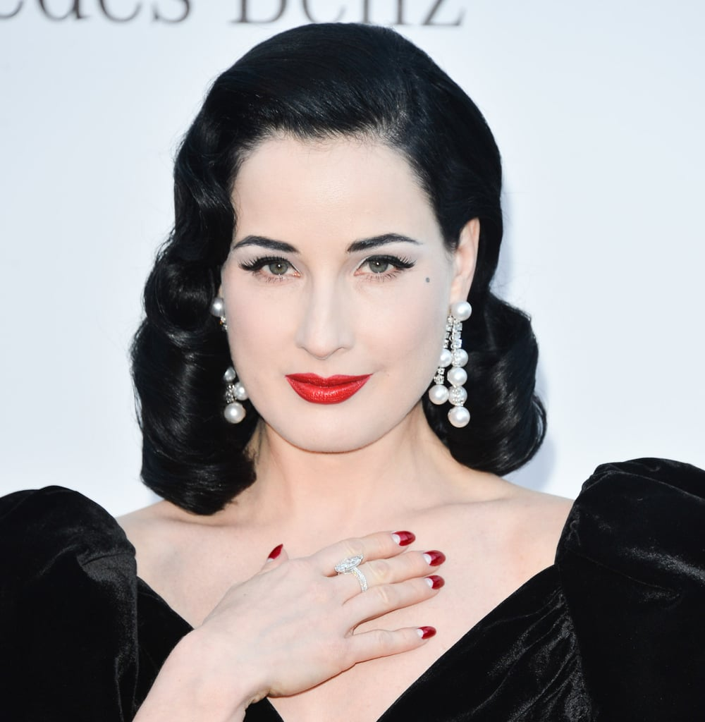 Dita Von Teese wore bold dangling pearl earrings.