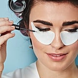 Then, she can use it as a template for her cat eye. Trust us, this is simple to DIY! Ensuring that the patches are aligned closely with your bottom lashline and the corner of your eye, trace your upper lashline from the center of your lid out to halfway towards your brow with your favorite liner. You should be using the eye patch as your guide throughout this process, relying on it for a sharp line even if your hand gets wobbly. Pro tip: do this first with a pencil, then layer a liquid liner on top for a more dimensional and durable wing. (Plus, you'll get a practice run with the pencil.) We like Urban Decay 24/7 Glide-On Eye Pencil in Zero ($24) topped with Stila Stay All Day Waterproof Liquid Eye Liner in Black ($22). Both formulas are waterproof, so you don't have to worry about smudging or smearing.