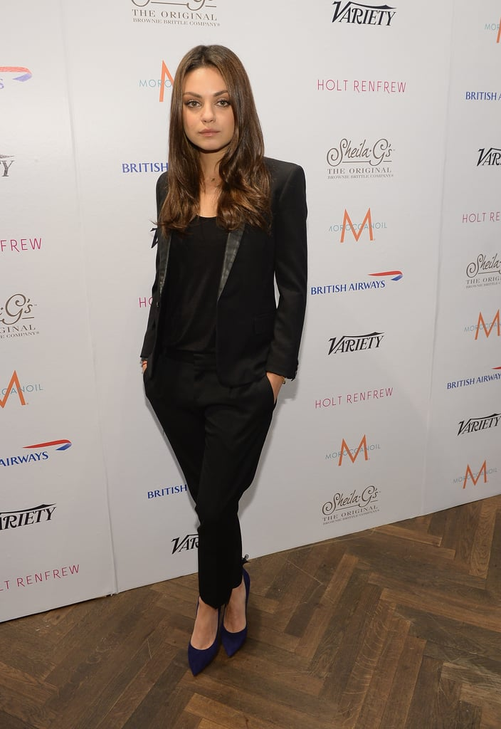 Mila Kunis dabbled with menswear in a black tuxedo suit and navy pumps in Toronto.