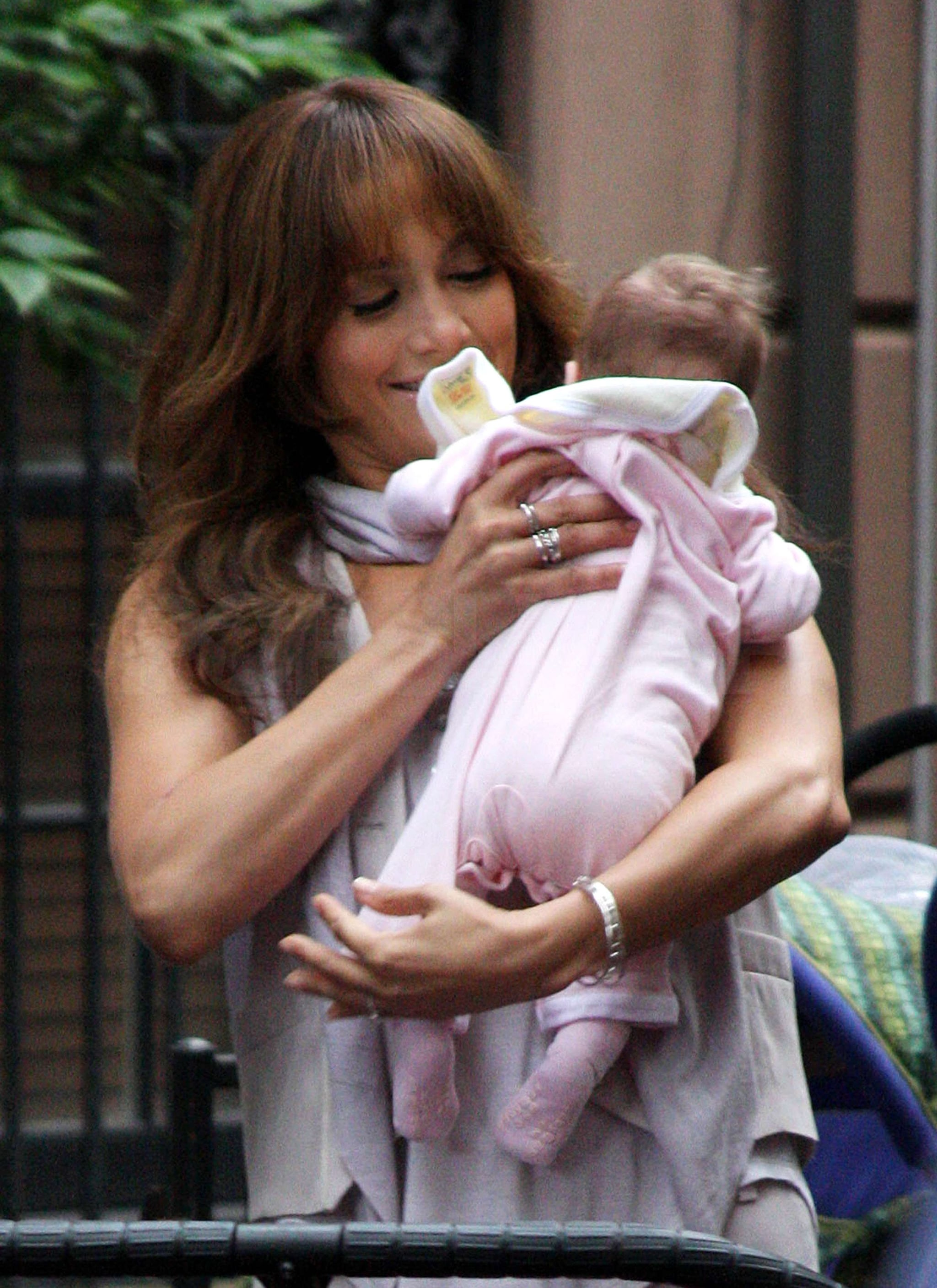 photos of jennifer lopez playing with twins on the set of