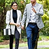 During another Australia stop, Meghan wore her Outland jeans with a sophisticated L'Agence blazer, Aquazzura bow slingbacks, Adina Reyter earrings, and a striped Oroton bag.