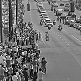 Thousands of mourners lined the streets in Memphis, TN, to watch Elvis's funeral procession.