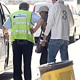 Halle Berry had the help of a friend getting into a car.
