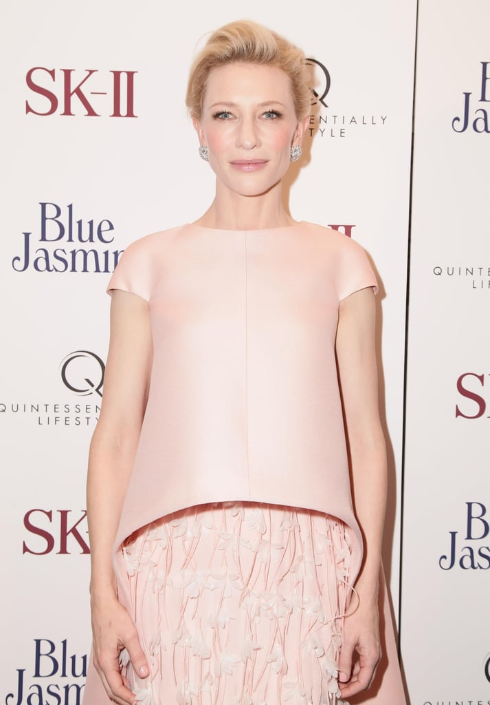 Cate's pretty makeup almost mimics the blush tones of her look.
