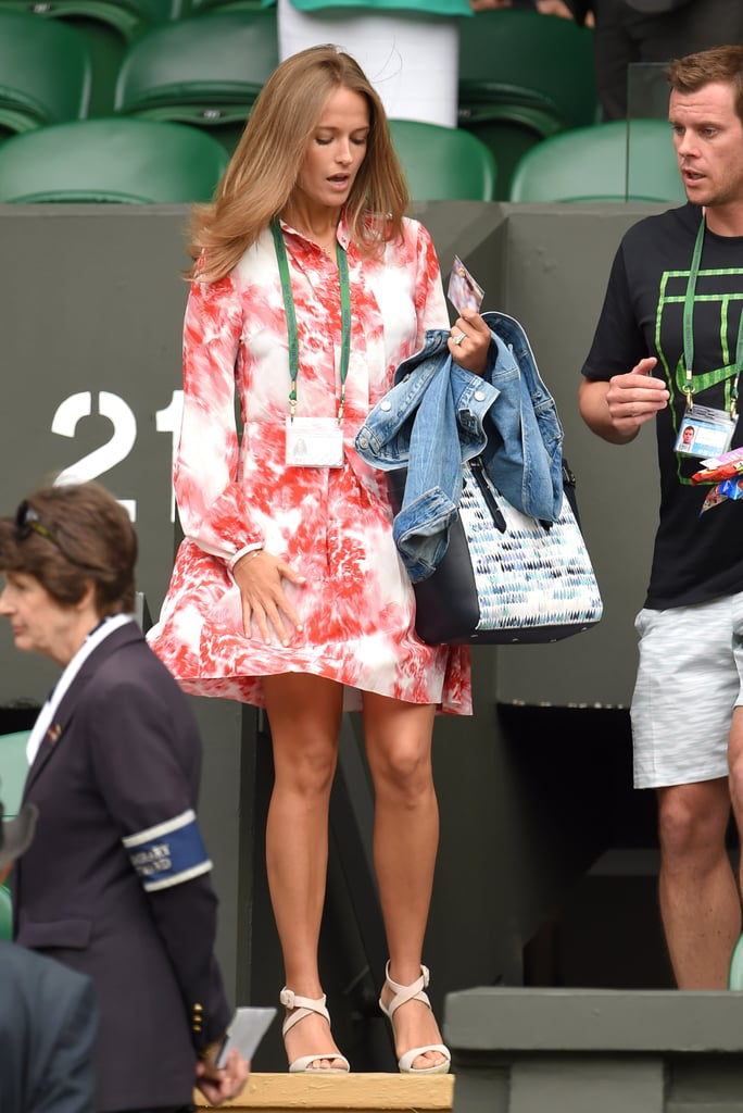 For a breezy Monday courtside at Wimbledon, Kim chose a red and white printed dress with long sleeves and her trusty handbag and sandals combo.