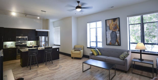 Each unit includes hardwood and/or stained concrete flooring, stainless steel appliances, and a washer and dryer.