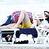 Jessica snuggled with her boyfriend while he was resting on a chaise.