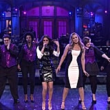 """After host Ronda Rousey welcomed Selena to the SNL stage, Selena sang a snippet of """"Come and Get It"""" wearing her first look of the night: a formfitting leather minidress with a white blouse underneath."""