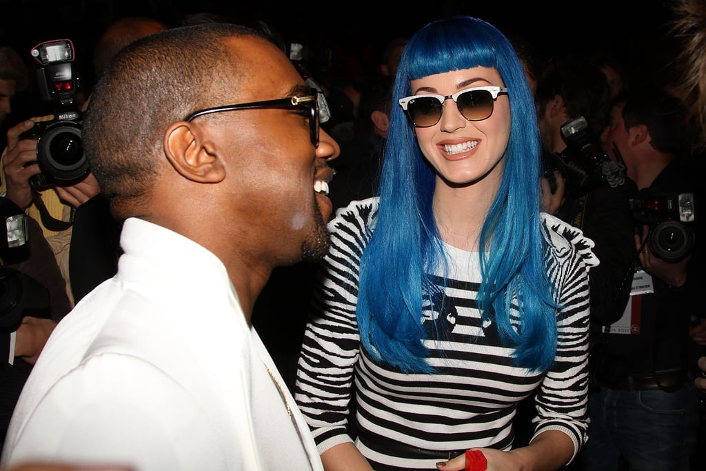 Katy Perry and Kanye West greeted each other yesterday at the Jean-Charles de Castelbajac runway show during Paris Fashion Week. Katy donned an electric blue wig for the presentation, where she and Kanye shared a hug before taking their seats in the front row. Kanye also attended Givenchy on Sunday, where he and Liv Tyler wore matching outfits. Those are just some of the celebrities who have traveled to the City of Lights for the stylish festivities. Jennifer Hudson and Zoe Saldana toasted Michael Kors at a party there earlier this week, and Blake Lively's new position as a Chanel spokesmodel was celebrated at a private dinner on Saturday night. Russell Brand didn't join his wife for her trip, but the pair spent some time together in LA last week before she headed to Europe and she was on his mind when he hit the red carpet in NYC on Monday.