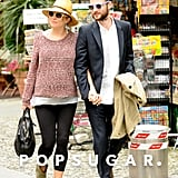 Sienna Miller and Tom Sturridge held hands as they took to the streets in Italy.