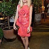 Sienna paired her bright pink Matthew Williamson dress with perfectly tousled hair in 2011.