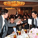 Taylor Lautner shook hands with Mark Wahlberg.