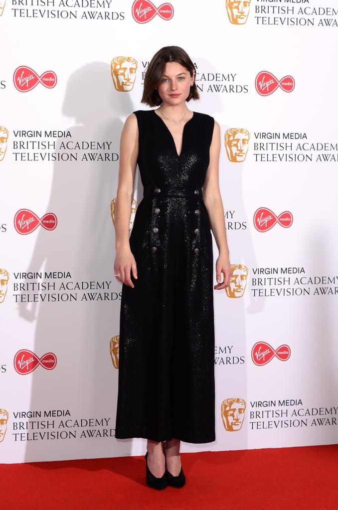 Emma Corrin Wears a Black Shimmering Jumpsuit