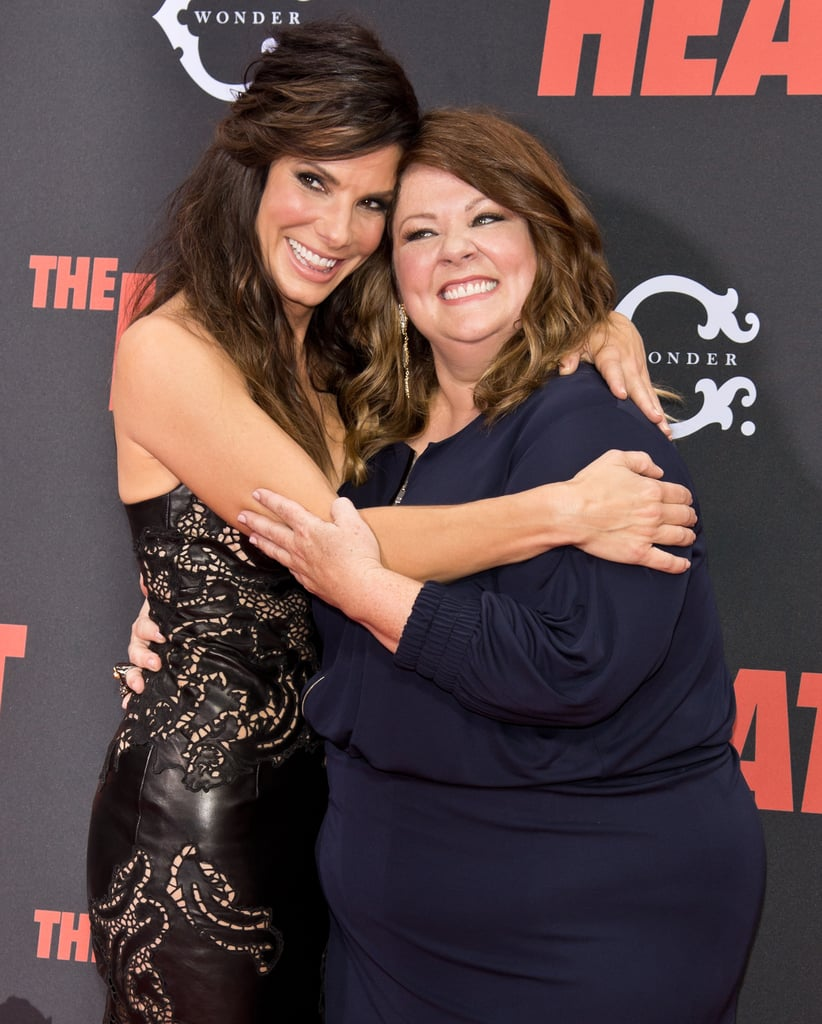 Sandra Bullock beamed on the red carpet with her friend Melissa McCarthy as they promoted The Heat in June 2013.