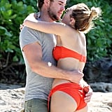 Liam Hemsworth and Miley Cyrus threw their arms around each other.