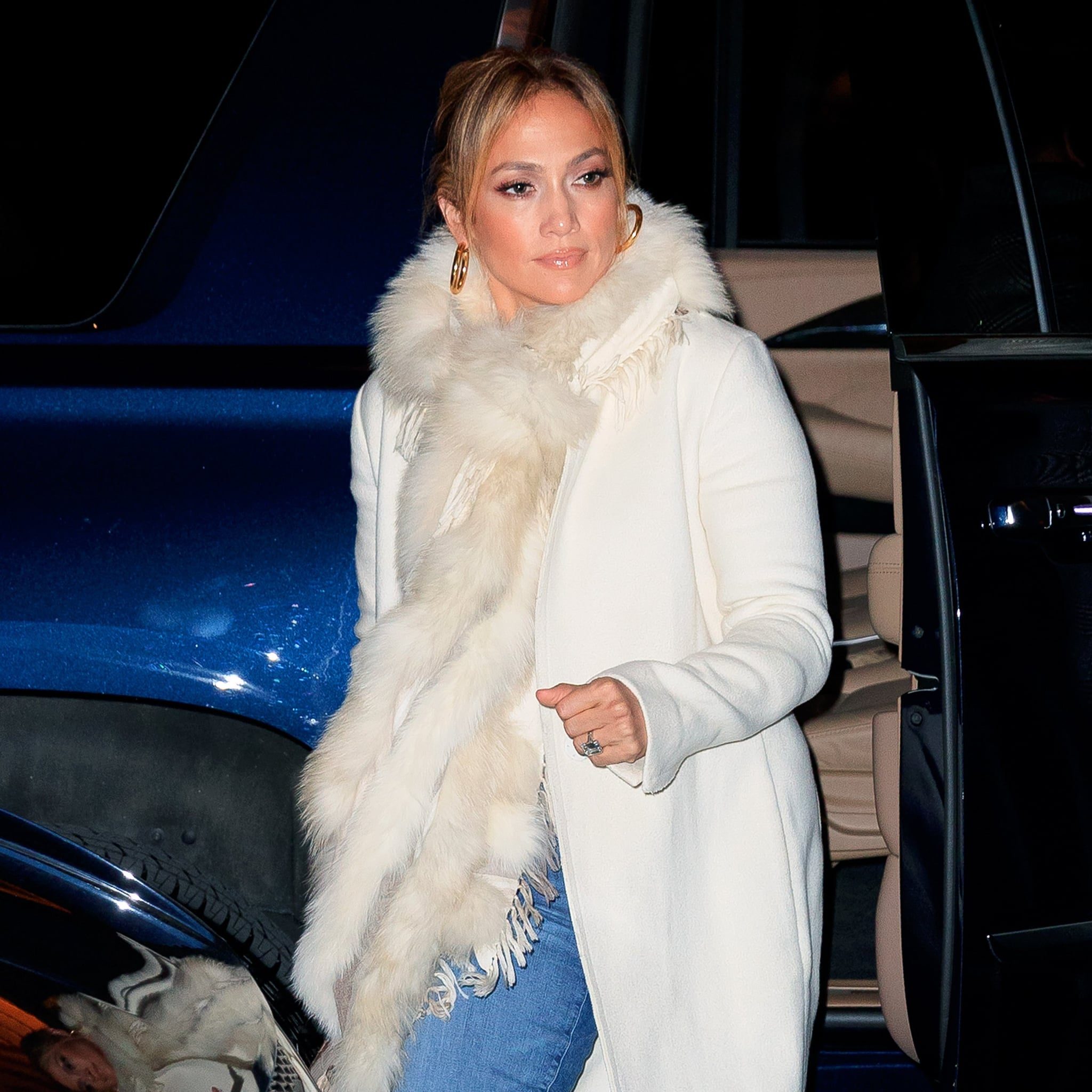 1702b050794 Jennifer Lopez s White Coat and Sneakers With Alex Rodriguez ...